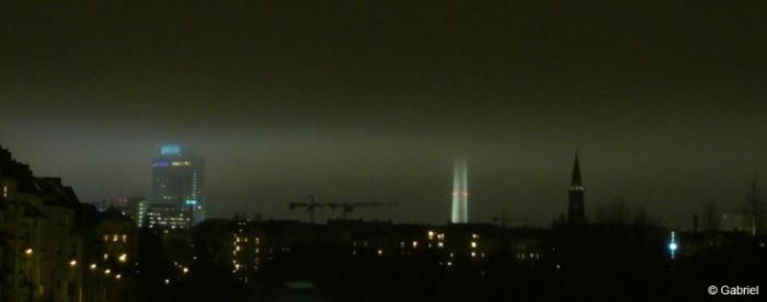 During night artificial light is reflected in low sheet cloud over Alexanderplatz Berlin, 2010